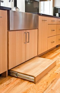 Contemporary Kitchen Cabinets Built Using Rift Cut White Oak With A Clear Finish Features Include A Roll Out Step Stool