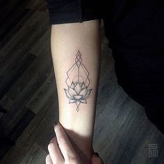 linework lotos tattoo