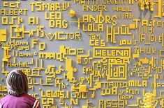 A Danish museum, for instance, has done much the same thing using two colors of LEGO brick to let kids sign their name on the wall, keeping the tonal palette basic and creating a writing-on-the-wall, black-and-white-worthy contrast.