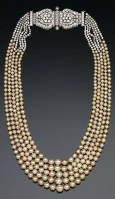An Art Deco pearl necklace, by Cartier, 1920s. An elegant example of the superb style and craftsmanship of Cariter, composed of five rows of graduated natural pearls with a magnificent diamond, pearl, and platinum clasp. The platinum clasp is a beautiful example of the Art Deco era