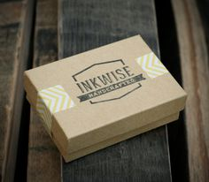 Boxes with tape on the sides and a stamp in the center. examples of coolness -Wood Earrings by Chase Kettl, via Behance
