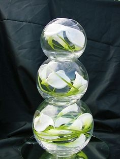 stacked fish bowls with calla lilies.