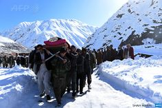 AFGHANISTAN, Khench: Afghan men carry the body of a victim of avalanches after funeral prayers in Khench district of Panjshir  province, north of Kabul on February 26, 2015. More than 200 people  have been killed in a series of avalanches triggered by heavy snowfall  around Afghanistan, officials said, warning the death toll could rise  still further.  AFP PHOTO / SHAH Marai