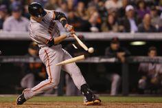 Buster Posey of the #SanFrancisco #Giants breaks his bat as he hits against the Colorado Rockies in Denver, #Colorado. http://www.dailyrecord.co.uk/news/uk-world-news/stunning-images-across-globe-3441264