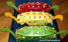 Schneller+Dinosaurierkuchen fertiger+Marmorkuchen+ein+Paket+Puderzucker+mit+etwas+Zitronensaft+kleine+Tube+Lebensmittelfarbe+Mini-Butterkekse+Smarties+Bastelpapier,+Farbe+nach+Belieben