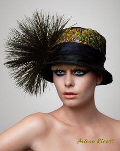 Peacock cloche Hat. $179.00, via Etsy.