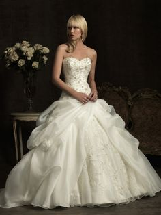 Long white strapless ball gown wedding dress with full skirt from Allure Bridals (Style: 8907).