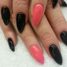 Stiletto nails with black and hot pink shellac. Insta: @boop711