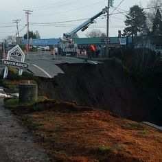 Sinkhole swallows up highway in Harbor, Oregon