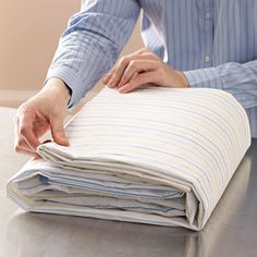Learn the fastest, easiest way to fold a fitted sheet with these helpful tips.