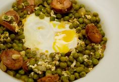 This is an easy recipe for a classic Portuguese stew of sweet green peas, Portuguese chorizo and eggs.