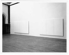 Robert Rauschenberg: White Paintings, 1951. Installation view of Robert Rauschenberg's White Painting [three panel] (1951, latex paint on canvas, Collection SFMOMA. On the right side of the wall) in the artist's Lafayette Street studio, New York. Photo: Dorothy Zeidman, 1991, courtesy the Robert Rauschenberg Foundation. © Robert Rauschenberg Foundation / Licensed by VAGA, New York, NY.
