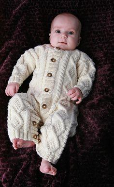 Ravelry: Baby Aran Bodysuit, Hat & Booties pattern by Eileen Casey