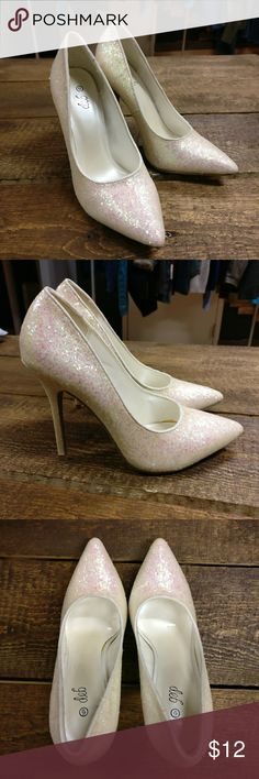 DEB Glitter Sparkle White High Heels DEB Glitter Sparkle White High Heels  Base color is white, sparkles have a very sheer pink hue  Women's size 6  Soles look perfect. Barely, if ever, worn.  Made in China. Deb Shoes Heels