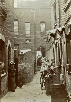 See the man looking over the wall in Union Place (off Wheler St) - photographs taken by Horace Warner in Spitalfields at the turn of the nineteenth and twentieth centuries