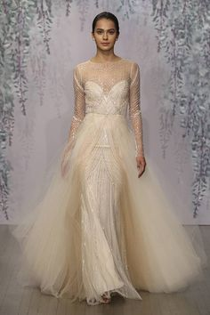 Art Deco is such a prolific wedding trend because of its lavish details and sumptuous glamour. Above, this princess dress is actually a sheath dress covered in a thick overlay of peachy tulle. The whole gown just glows.