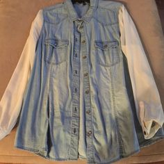 Jeans shirt Light jean shirt with sheer sleeves. It was unique so I bought it. I guess I wore it two or three times. All of my listings are wrinkled because they are packed in my closet like sardines  Jessica Simpson Tops Button Down Shirts