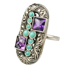 An Art Deco ring with turquoise, amethyst and marcasite. Sized 6.25-6.5. Shown with two other rings by Theodore Fahrner. Germany circa 1920s