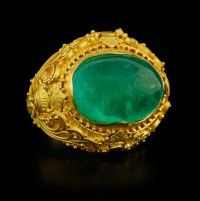Carolyn Tyler Emerald Ring      This gorgeous cabochon Emerald of 11.47 carats is bezel set in a 22k yellow gold setting with intricate granulation detail.