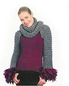 Easy to knit and a delight to wear, the new knitted criss-cross shrug is versatile, hip and flattering too! This simple and stylish shrug is a long rectangle, with a seamed 'sleeve' at each end. It can be wrapped and draped in several different ways. Optional fringe on the sleeves gives a splash of color. (LionBrand.com)