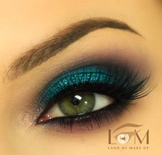 sorta like her eye makeup but the eyeliner is thicker and the eye shadow is kinda sparkly