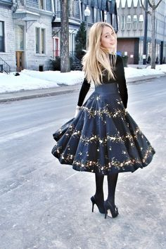 tight monochrome black with whimsical full skirt. hair up instead of down.