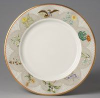 "State dinner service of Lyndon Baines Johnson (President 1963-1969)--Dinner Plate/Made in New Castle, Pennsylvania c. 1968--Designed by Van Day Truex, André Piette, and Claudia Taylor ""Lady Bird"" Johnson. Made by Castleton China, subsidiary of Shenango Pottery Co., New Castle, PA, active 1939 - 1976. Ordered from Tiffany & Company, New York, 1853 - present. Porcelain with printed, enamel, and gilt decoration. Diameter: 10 3/4 inches (27.3 cm)"