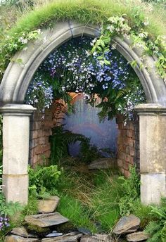 Mystical Arch, Provence, France This is so lovely! I love the ferns & lobelia hanging from the top. Favorite!*