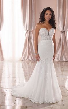 This mermaid wedding dress starts at the subtly sheer bodice, layered with organza to maintain coverage—showered in organic laces over the deep plunge of the strapless sweetheart neckline. The floral laces transition effortlessly from the sheer bodice onto the solid crepe skirt, creating a negative space effect that truly offers the best of both worlds!