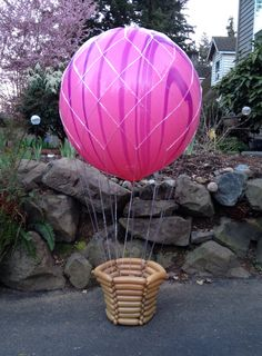 Hot air balloon decor, complete with a balloon basket #iamconwin #qualatex #insanechastainballoons