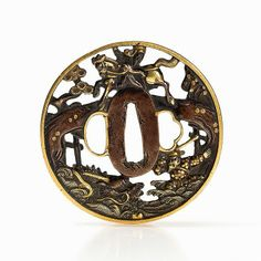 This ornamental open work tsuba was made in the Japanese Edo period (1603-1867) and consists of inlays in shibuichi, shakudo and shows gold and silver overlays as well as silver plating and gilding. The tsuba shows a design in sukashibori with iroezogan of warrior on a bridge and another confronting a dragon's head that rises out of the waves and gnarled pines are rendered at the edges. The outer edge is covered with gold.  The dimensions are approx. 8 x 8 cm