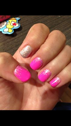 Hot pink gel manicure with glitter gradation