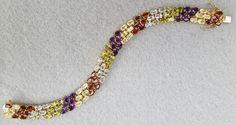 Vintage Vermeil gold over sterling multi gemstone bracelet; amethyst, garnet, citrine, white and blue topaz. Minty, fluid, fabulous and just opulent!
