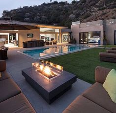 Contemporary Patio with Outdoor kitchen, Fire pit, Gravelstone Rectangle Gas Fire Table, exterior tile floors, Pathway