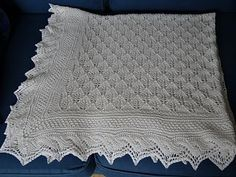 In 2013, I fell in love with two baby blankets, both soft-draping, patterned and lacy. The first one was the Yarn Harlot's Baby Blanket completed in October 2013 and the second was the blanket Prince George had been swaddled in when he left the maternity hospital earlier that year. Sadly neither has an available pattern: the first was a special gift and SPMcP didn't publish her design so she could keep it unique, whilst the second was a mass-produced, manufactured blanket. Knitted Afghans, Knitted Baby Blankets, Baby Afghans, Lace Knitting, Baby Knitting Patterns, Baby Patterns, Crochet Baby, Knit Crochet, Baby Shawl