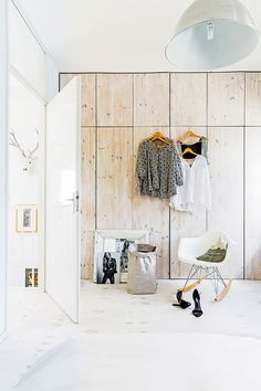 Storage is maximised in the master bedroom with floor-to-ceiling cupboards. The timber has been whitewashed to suit the rest of the home's scheme.
