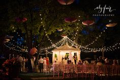Love the lights, love the umbrellas vintage circus themed wedding, big top lights