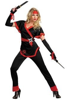 "Dragon Lady Ninja Costume - Calgary, Alberta. This Ninja is the perfect costume for teachers or parents to wear at a school Halloween event.  This is a classic ladies Ninja costume. Be the shadow in the dark this Halloween.  The Ninja costume is a pair of black satin pants with red cuffs and an elastic waist. The top appears as a tied up karate shirt and is black and red. There is a red silkscreened dragon in the lower right of the shirt and a throwing star at the left side by the ""tie""."
