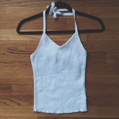90's white ribbed slightly cropped halter Super cute, perfect for the summer! Has a built-in-bra. Love this lil halter, but it looks a little weird on my boobs. Can't have it all I guess. No brand, thrifted. BRANDY MELVILLE FOR EXPOSURE ✨ Brandy Melville Tops Tank Tops