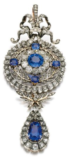 A Victorian sapphire, colour change sapphire and diamond brooch/pendant, 1890s. Of foliate and bow design, set with oval and cushion-shaped sapphires, suspending a pear-shaped colour change sapphire, further set with cushion-shaped and rose diamonds. #Victorian #antique #brooch #pendant Gems Jewelry, Art Deco Jewelry, Jewelery, Jewelry Accessories, Fine Jewelry, Jewelry Design, Victorian Jewelry, Antique Jewelry, Vintage Jewelry