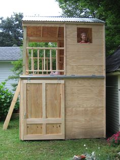 perfectly simple shed with playhouse on top