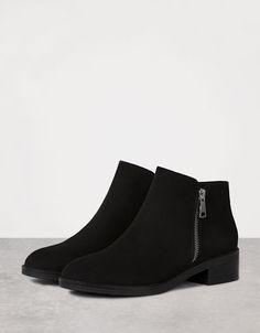 Flat zip-up ankle boots. Discover this and many more items in Bershka with new…