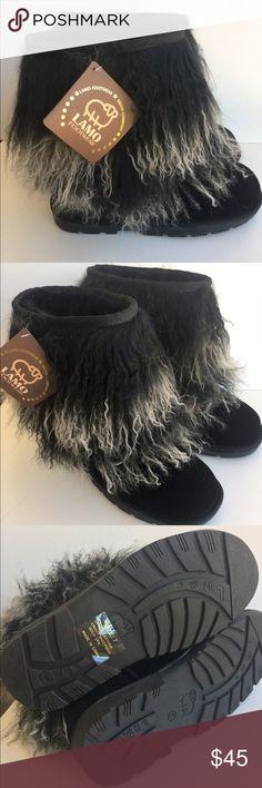Nib black sheepskin boots 7 New in boxes, genuine Australian Sheepskin boots for women, by Lamo. black -size 7. Retail 120-130$. Lamo Shoes Winter & Rain Boots