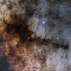 East of Antares, dark markings sprawl through crowded star fields toward the center of our Milky Way Galaxy. Cataloged in the early 20th century by astronomer E. E. Barnard, the obscuring interstellar dust clouds include B59, B72, B77 and B78, seen in silhouette against the starry background. Here, their combined shape suggests a pipe stem and bowl, and so the dark nebula's popular name is the Pipe Nebula.