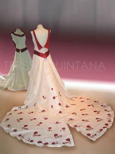 Vestido de novia evasé largo, con apliques en doupión rojo. Cola desmontable con flores rojas aplicadas