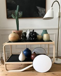 Scandinavian ceramic collection. Table by Alvar Aalto. Lamp by Arne Jacobsen. #everclassic #everclassicom #alvaraalto #arnejacobsen #salto…