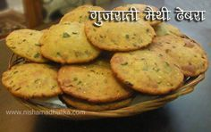 Gujarati Methi Dhebra Recipe Bajra flour- 250 grams(2 cup) Wheat flour - 175 grams (1.5 cup) Suji(semolina) - 100 grams ( 3/4 cup) Cornflour - 50 grams (1/3 cup) Green Methi leaves - 2 cup Til(sesame seeds) - 1 tbsp Jeera(cumin) - 1/2 tsp Sour curd - 200 grams (1 cup) Gur(jaggery) - 1 tsp Salt - add to taste (1 tsp) Green chilli - 2 Ginger- 1 inch long piece Red chilli powder - less than 1/4 tsp Turmeric powder - less than 1/4 tsp Oil - to fry Dhebra