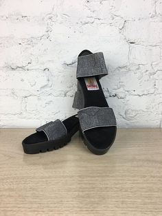 """You like totally need these sandals! Stretchy silver straps, black platform, chunky heel AND they appear to have never been worn. Do you live in the Chicago? Skip the shipping! Use the code """"IMLOCAL"""" at checkout to waive the shipping fee and arrange to pick up your item at our"""