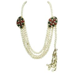 Vintage Signed Chanel 1983 Gripoix Glass & Faux Pearl Necklace   From a unique collection of vintage multi-strand necklaces at https://www.1stdibs.com/jewelry/necklaces/multi-strand-necklaces/