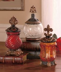 Elegant Glass Jar offers a lovely storage option, as well as a pretty room accent. The goldtone and brasstone lid, base and trim combine with the crackled glass jar to give the piece the look of an expensive antique. Use it to hold potpourri, wrapped
